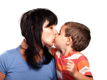 Mother and little son kissing isolated on white photo