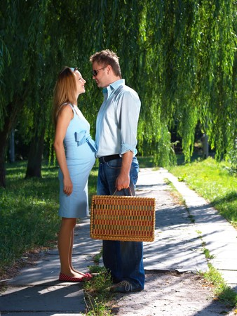 Loving couple standing on the road with suitcase in hands photo