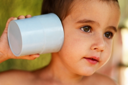 Boy plays with a toy communication device