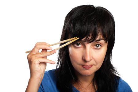 sceptic: Sceptic woman with chopsticks isolated on white