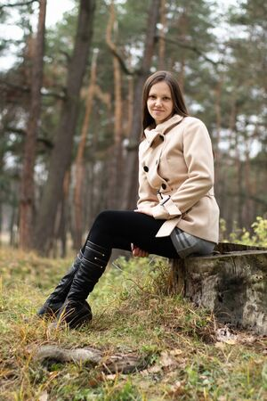 jackboot: Young woman in white coat outdoors in autumn
