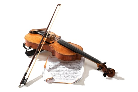 Old violin bow and notes crossed isolated on white photo