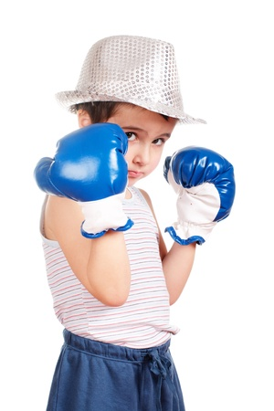 Little boy in hat boxing isolated on white photo