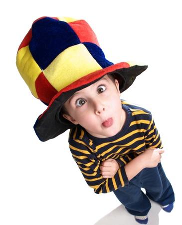 Little clown boy making grimace on white background