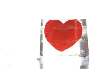 Frozen paper heart in piece of ice photo