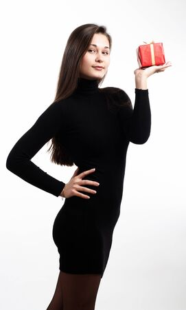 Woman in black dress with red gift box Stock Photo - 8884598