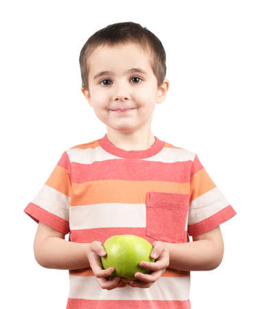 Smiling boy with green apple isolated on white