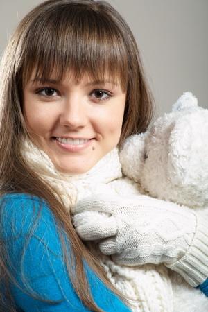 Beautiful winter girl with white teddy bear photo