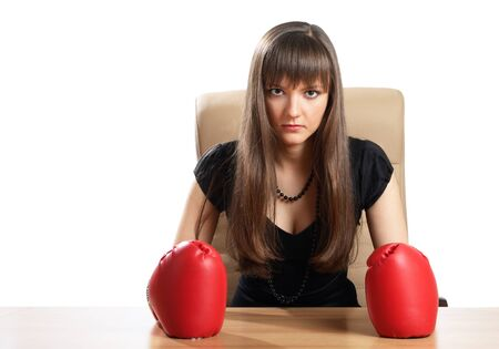 Woman in boxing gloves in the office isolated on white photo