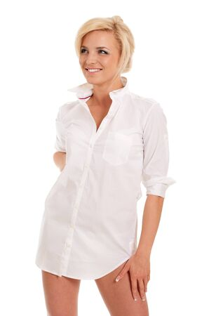 Gorgeous blonde woman in white shirt with naked hips isolated on white