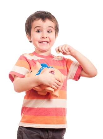Litle boy puts the coin into the piggy bank isolated on white Stock Photo