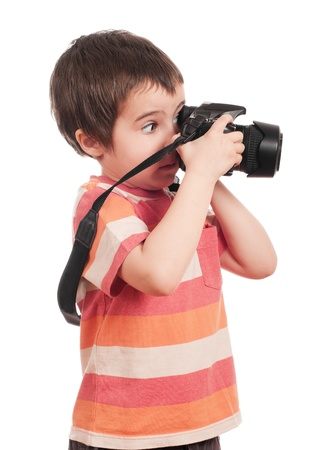cameraman: Little boy photographer with slr camera isolated on white Stock Photo