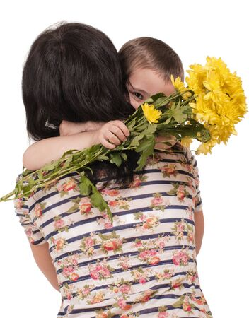 Mother and son hugging with flowers isolated on white photo