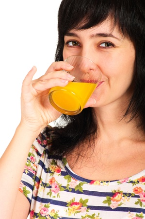 Portrait of woman drinking orange juice glass isolated on white photo