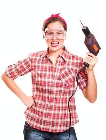 Screaming woman construction worker in protection glasses with drill isolated on white photo