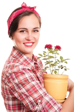 Beautiful happy housewife in kerchief with rose flower pot isolated on white
