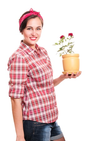Happy housewife in kerchief with rose flower pot isolated on white Stock Photo - 9722475