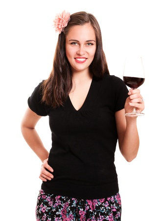 Beautiful young girl with flower in hair holding glass of wine isolated on white photo