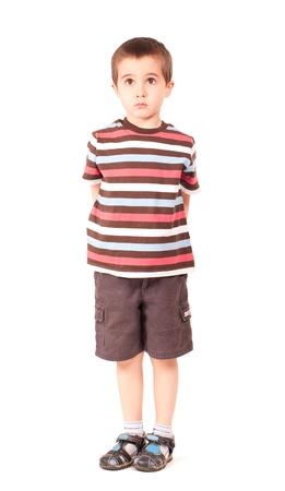 Single sad little boy looking outside upwards isolated on white