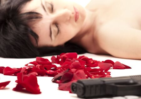 Suicide naked woman lying on the floor with gun and metaphoric blood Stock Photo - 9959387