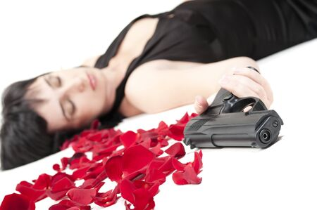 corpse flower: Suicide woman lying on the floor with gun and metaphoric blood isolated on white Stock Photo