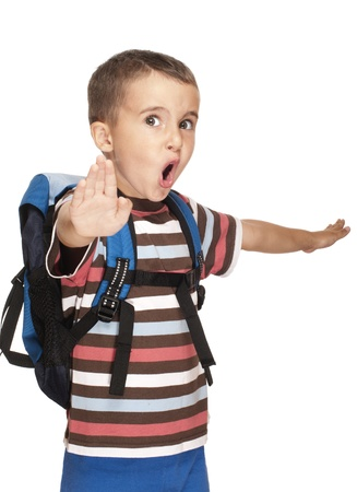 Little boy with backpack pretends kung-fu isolated on white