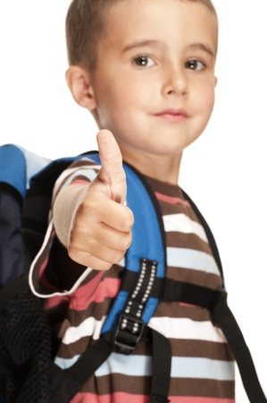 Little boy with backpack shows thumb up sign isolated on white Stock Photo - 10043452