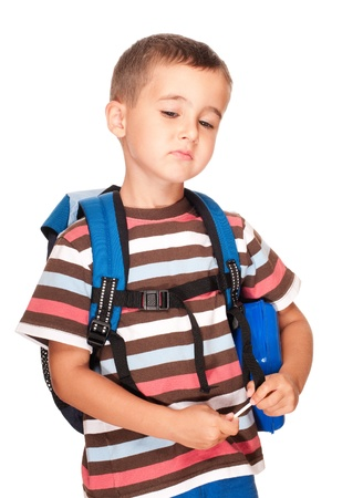demotivated: Little boy elementary student with backpack and sandwich box upset isolated on white Stock Photo