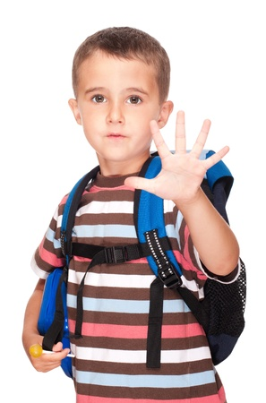 Little boy elementary student with backpack and sandwich box shows five fingers isolated on white photo