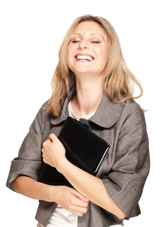 Happy laughing student woman holding laptop insolated on white Stock Photo