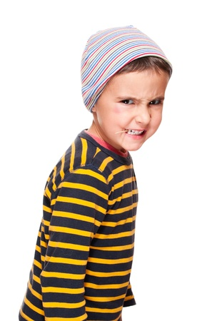 sullenly: Little rage bully with toothpick and black eye in striped sweater cap  isolated on white Stock Photo