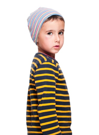 homeless children: Poor homeless orphan child boy in striped sweater isolated on white