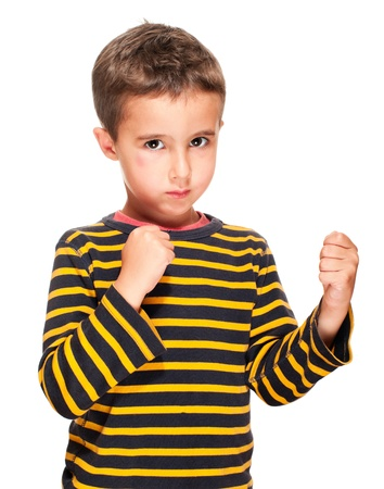 sullenly: Little bully boy with black eye in fighting stance isolated on white