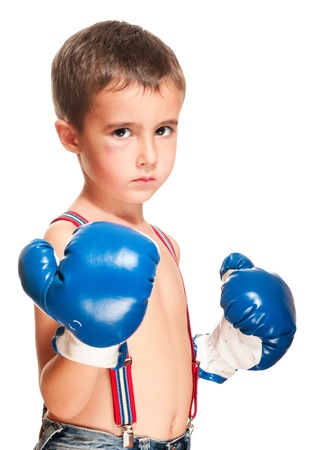 sullenly: Little bully boy with black eye in boxing gloves fighting stance isolated on white Stock Photo