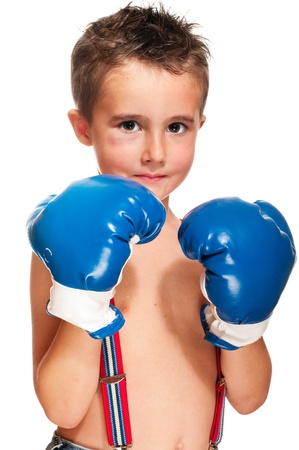 Little bully boy with black eye in boxing gloves wet isolated on white photo