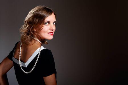 Coquette retro woman in pearls turn around