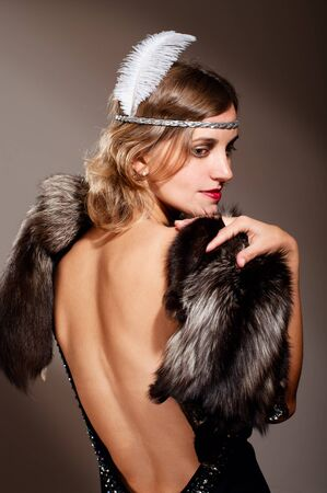 Portrait of retro woman in evening dress and fur with feather Stock Photo - 11519125