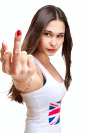 탱크 탑: 가운데 손가락을 보여주는 영국 국기와 탱크 톱에 젊은 아시아 소녀 흰색에 고립 스톡 사진