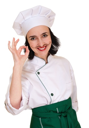 Beautiful woman in chef uniform with ok sign isolated on white photo
