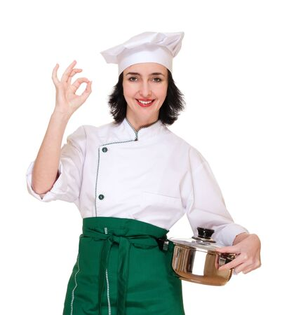 Woman in chef uniform with ok sign and pan isolated on white photo