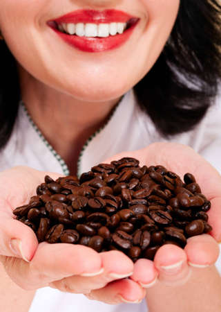 sniff: Coffee and smile. Woman sniff roasted beans