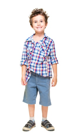 Naughty hairy little boy in shorts and shirt isolated on white photo