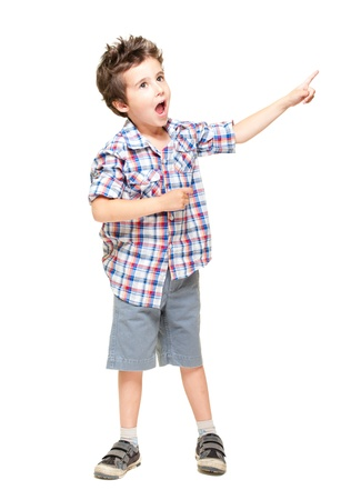 boy shorts: A little excited boy pointing at something isolated on white