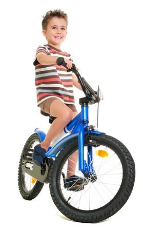 Happy little boy on bike  isolated on white Stock Photo