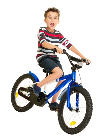 Excited little boy on bike isolated on white