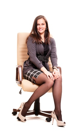 Business woman in leather chair isolated on white photo