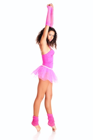 Dancer black girl in pink ballet tutu stretching isolated on white photo