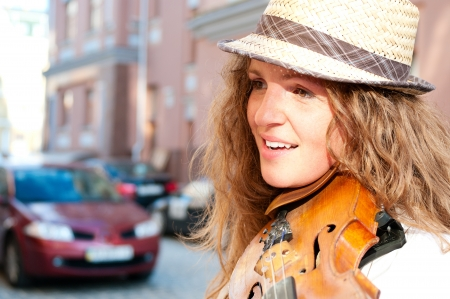 woman violin: Portrait of woman violin on the street
