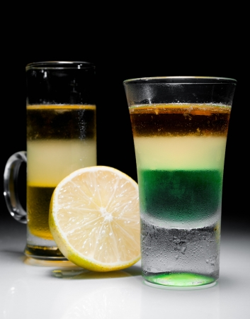 Green mexican and melon liquer shot cocktail with lemon slice photo