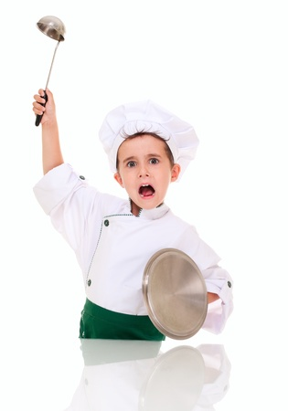 Little angry boy cook threaten with kitchen utensil isolated on white photo